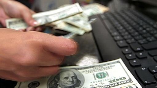 Perspectiva de alteração na política monetária dos EUA, crise na Ucrânia e dados do setor externo definiram a alta da moeda - Clayton de Souza/Estadão