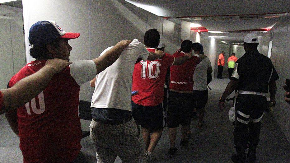 Chile fans are lead out by police after they broke into the press center prior to the group B World Cup soccer match between Spain and Chile at the Maracana Stadium in Rio de Janeiro, Brazil, Wednesday, June 18, 2014.  (AP Photo/Frank Augstein)