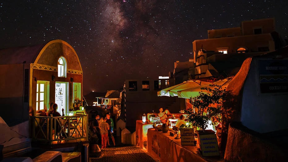 Oia, Santorini Island, Greece: Heavenly display: The Milky Way presides over candlelit restaurants during a blackout caused by a fire in a power station. Santorini, or Thera, is among the 200 small islands in the Cyclades. (CREDIT: BABAK TAFRESHI/National Geographic Creative) # 1761338
