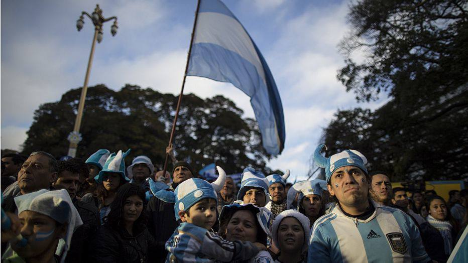 Argentina soccer fans watch the World Cup semifinal match between Argentina and Netherlands on an outdoor screen set up in Buenos Aires, Argentina, Wednesday, July 9, 2014. Argentina made it to the World Cup final with a 4-2 shootout win over the Netherlands after the game finished in a 0-0 stalemate. (AP Photo/Ivan Fernandez)