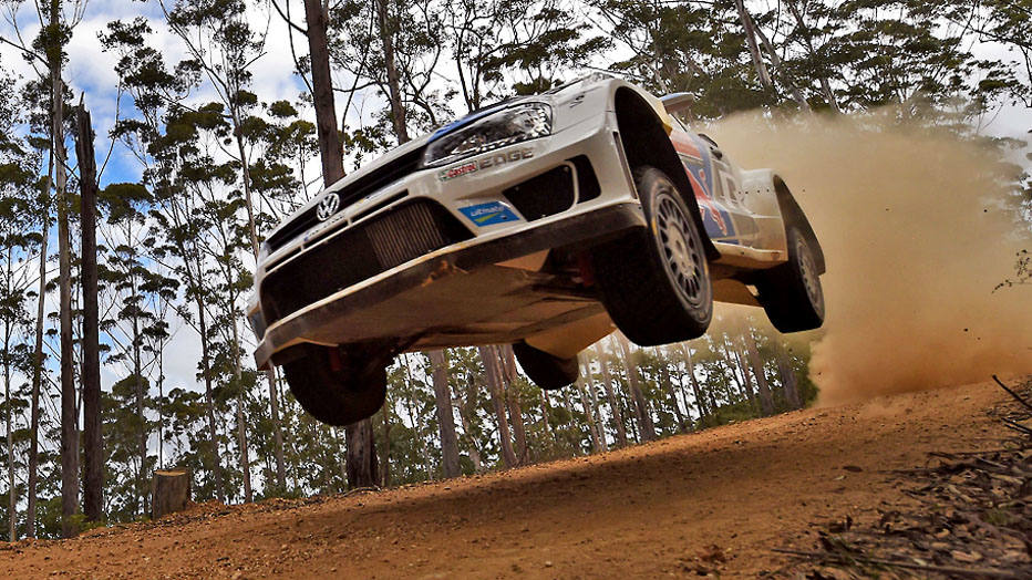 French rally driver Sebastien Ogier jumps his Volkswagen Polo over a brow during the fifth special stage of the World Rally Championship (WRC) Rally of Australia, near Bellingen on the New South Wales central coast on September 12, 2014.  AFP PHOTO/William WEST
