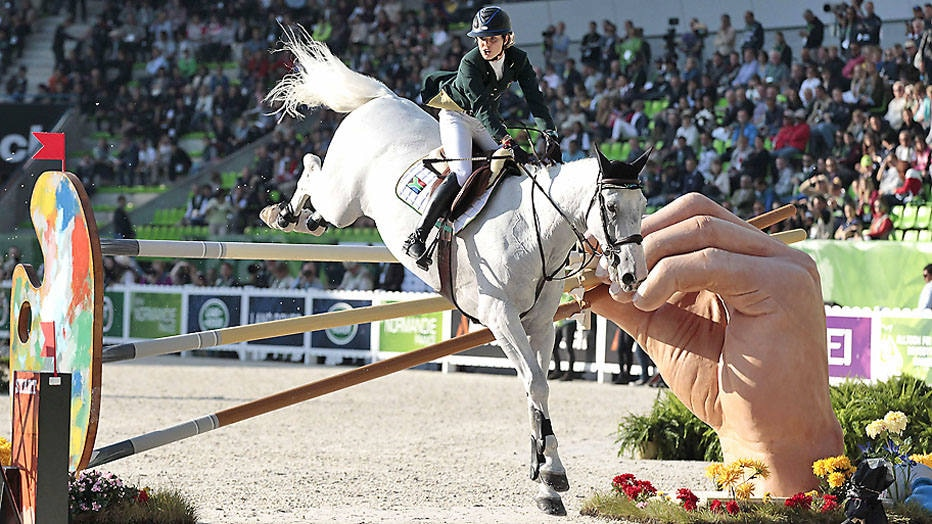 South African Cara Bianca Frew rides Leopold Pierreville on September 3, 2014 during the Individual Jumping competition of the 2014 FEI World Equestrian Games, in the northwestern French city of Caen. AFP PHOTO / CHARLY TRIBALLEAU.