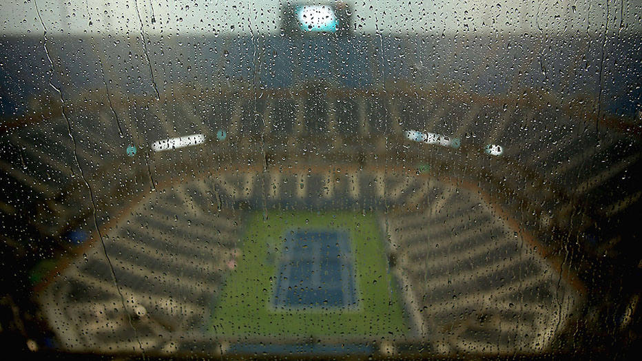 NEW YORK, NY - AUGUST 31: A view of rain drops collect as rain falls on Arthur Ashe Stadium to suspend play on Day Seven of the 2014 US Open at the USTA Billie Jean King National Tennis Center on August 31, 2014 in the Flushing neighborhood of the Queens borough of New York City.   Matthew Stockman/Getty Images/AFP