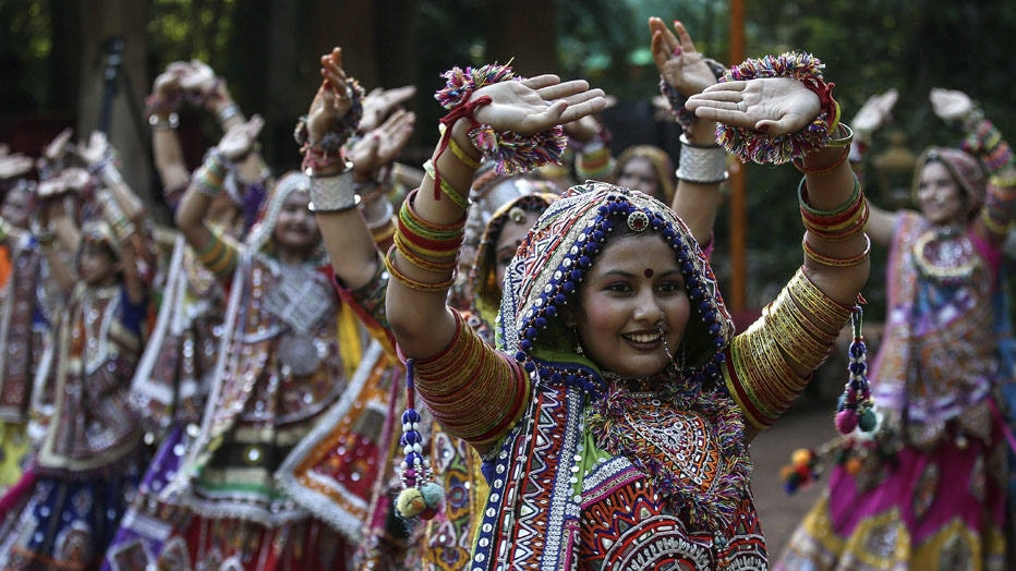 . Ahmedabad (India), 21/09/2014.- Indian girls wearing traditional costume participate in a Garba dance practice ahead of the Navratri festival celebrations in Ahmedabad, India, 21 September 2014. The word Navaratri literally means nine nights in Sanskrit. During Navratri, nine forms of Durga (Hindu Mother Goddess) are worshiped. Navratri is a festival of worship, dance and music celebrated over a period of nine nights; the tenth day is commonly referred as Vijayadashami or Dussehra. This year Navaratri festival starts from 25 September. EFE/EPA/DIVYAKANT SOLANKI