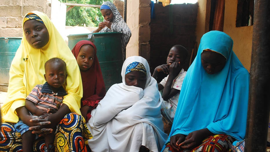 Women and children, who escaped from violence after Boko Haram insurgents attacked their community weeks ago, sit together at the internally displaced persons (IDP) camp at Wurojuli, Gombe State September 2, 2014. African leaders proposed on Tuesday creating a special fund to combat Islamist militant groups growing in strength from Kenya to Nigeria. African Union (AU) states announced the idea after Nairobi talks on a problem highlighted on Tuesday by capture of a town in north-eastern Nigeria by Boko Haram militants. Fighting killed scores of people, according to security forces, and sent at least 5,000 fleeing. Picture taken September 2.   REUTERS/Samuel Ini (NIGERIA - Tags: CIVIL UNREST POLITICS)