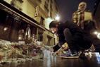 Franceses homenageiam vítimas do ataque terrorista no restaurante Carillon, em Paris