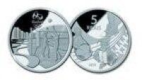 Neste terceiro conjunto, a moeda de prata com valor de cindo reais retrata o vôlei de praia em Copabana uma face e o forró naoutra
