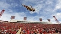 CALGARY, CANADA - SEPTEMBER 1: A cheerleader for the Edmonton Eskimos goes flying through the air while they played the Calgary Stampeders during their CFL football game September 1, 2014 at McMahon Stadium in Calgary, Alberta, Canada.   Todd Korol/Getty Images/AFP