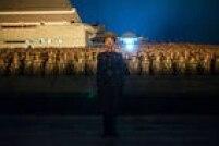 Norte-coreanos comemoram os 70 anos do Partido dos Trabalhadores da Coreia do Norte. Foto: Ed Jones /  AFP
