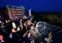 Hungria levanta cerca de arame e protege até vagões contra imigrantes