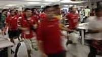 Chile fans run through the press center prior to the group B World Cup soccer match between Spain and Chile at the Maracana Stadium in Rio de Janeiro, Brazil, Wednesday, June 18, 2014.  (AP Photo/Akmal Rajput)