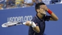 Novak Djokovic of Serbia makes fun of himself after missing a shot to Andy Murray of Britain during their quarter-final men's singles match at the 2014 U.S. Open tennis tournament in New York early on September 4, 2014.  REUTERS/Ray Stubblebine (UNITED STATES  - Tags: SPORT TENNIS TPX IMAGES OF THE DAY)