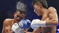 Naoya Inoue (R) of Japan punches Samartlek Kokietgym of Thailand during their WBC light flyweight boxing title match in Tokyo September 5, 2014.