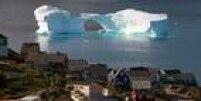Povoado à beira de geleira na Groenlândia