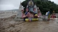Floodwaters engulf temples in Jammu, India, Saturday, Sept. 6, 2014. Heavy monsoon rains have caused flash floods and landslides that left more than 100 people dead in the disputed Himalayan region of Kashmir and in eastern Pakistan, officials said Friday. (AP Photo/Channi Anand)
