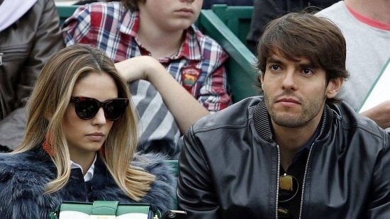 Brazil's soccer player Ricardo Kaka (R) and his wife Caroline Celico (L) attend the final tennis match of the Monte Carlo Masters between Switzerland's Roger Federer and Stanislas Wawrinka, in Monaco April 20, 2014. REUTERS/Eric Gaillard (MONACO - Tags: SPORT TENNIS SOCCER)