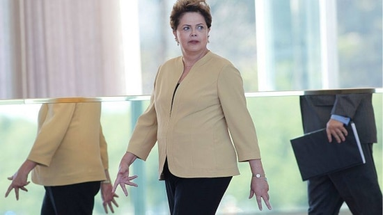 Brazil's President Dilma Rousseff arrives for a meeting with Colombia's President Juan Manuel Santos at Alvorada palace in Brasilia, Brazil, Thursday, June 19, 2014. (AP Photo/Eraldo Peres)