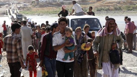 Yazidis abandonam suas casas e fogem de violência do Estado Islâmico