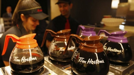 Tim Hortons employees prepare coffee before the company's annual general meeting in Toronto, in this file photo taken May 8, 2014. Burger King Worldwide is in talks to buy Canadian coffee and doughnut chain Tim Horton's, according to the Wall Street Journal, in a deal that would be structured as a tax inversion to move the hamburger chain's domicile out of the United States.   REUTERS/Peter Jones/Files   (CANADA - Tags: FOOD BUSINESS)