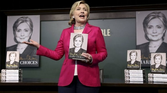 "Hillary Rodham Clinton holds a copy of her new memoir during a signing event in the Barnes & Noble at Union Square in New York, June 10, 2014. Clinton's memoir ""Hard Choices"" was released Tuesday. (Chang W. Lee/The New York Times)"
