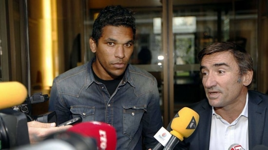 Bastia's Brazilian forward Brandao (L) and his lawyer Olivier Martin speak to the press after a hearing at the French professional fooball league (LFP) on August 21, 2014, in Paris. Martin announced that Brandao was provisionnally suspended until September 18, 2014 by the French league's disciplinary authority for giving Paris' Brazilian player Thiago Motta a headbutt on August 16, after the French L1 football match between Paris and Bastia. AFP PHOTO /THOMAS SAMSON
