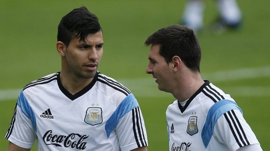 Argentina's Sergio Aguero, left, talks with teammate Lionel Messi during a training session in Vespasiano, near Belo Horizonte, Brazil, Thursday, June 12, 2014. Argentina will play in group F of the Brazil 2014 soccer World Cup. (AP Photo/Victor R. Caivano)
