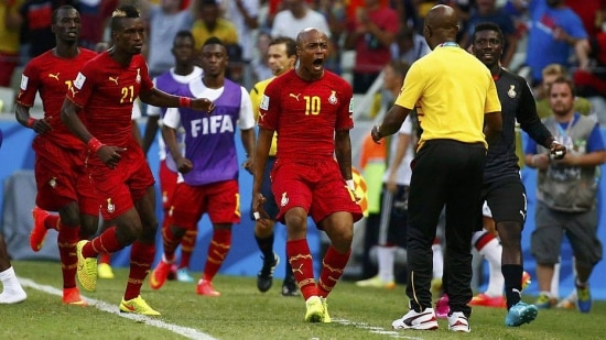 Ghana's Andre Ayew (10) celebrates his goal against Germany with coach Kwesi Appiah during their 2014 World Cup Group G soccer match at the Castelao arena in Fortaleza June 21, 2014. REUTERS/Paul Hanna (BRAZIL  - Tags: SOCCER SPORT WORLD CUP)