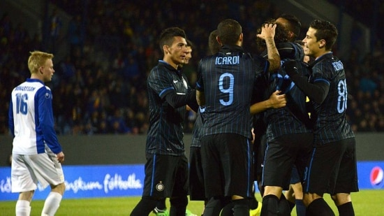 Inter Milan players celebrate after Brazilian defender Dodo (2nd, R) scored his teams second goal during the UEFA Europa League play off match between Stjarnan and Inter Milan at the Laugardalsvollur stadium in Reykjav
