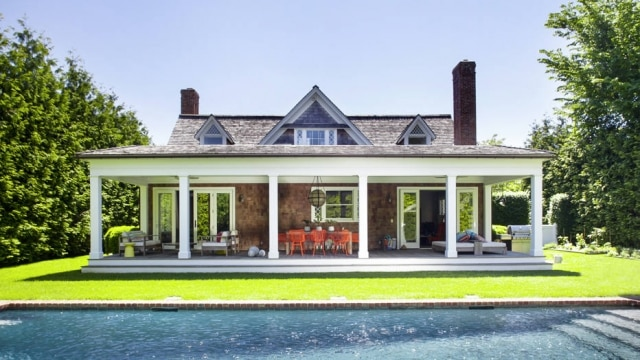 A 1890s house in Southampton, N.Y. that underwent a complete overhaul back to a single-family residence after having been carved up into three separate apartments, June 6, 2014. The expansive back porch and pool were added during renovations. (Eric Striffler/The New York Times)