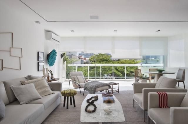 As salas de estar e de jantar, agora incorporadas à varanda