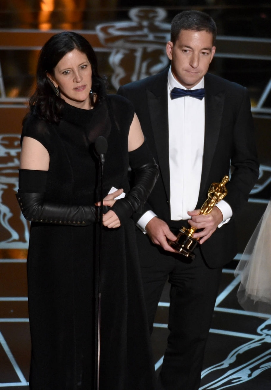 Laura Poitras e Glenn Greenwald na entraga do Oscar 2015 - John Shearer/Invision/AP