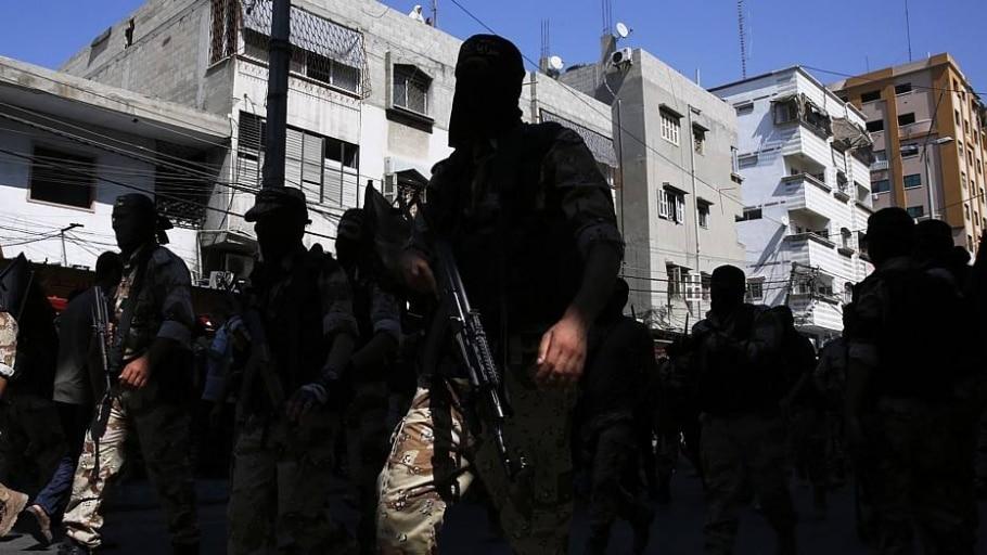 Demonstração de força de militantes palestinos - ROBERTO SCHMIDT/AFP