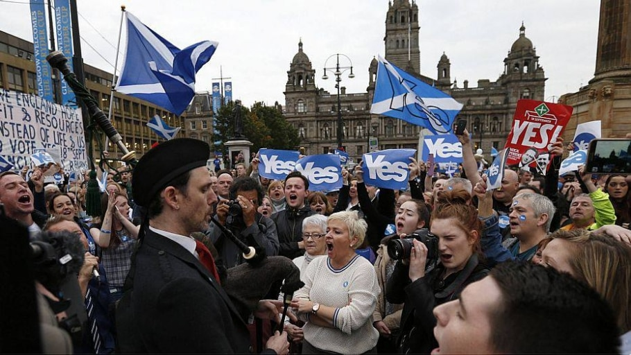 Yes supporters congregate in George Square in Glasgow , Scotland - Russell Cheyne/Reuters