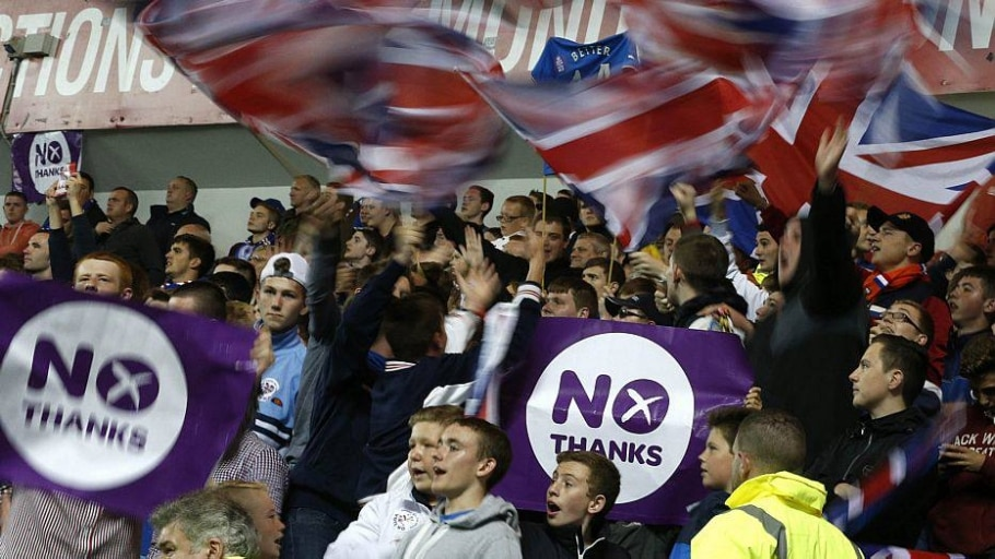 Rangers fans display No Thanks posters during the Rangers versus Inverness Caledonian Thistle soccer match in Glasgow - Russell Cheyne/Reuters