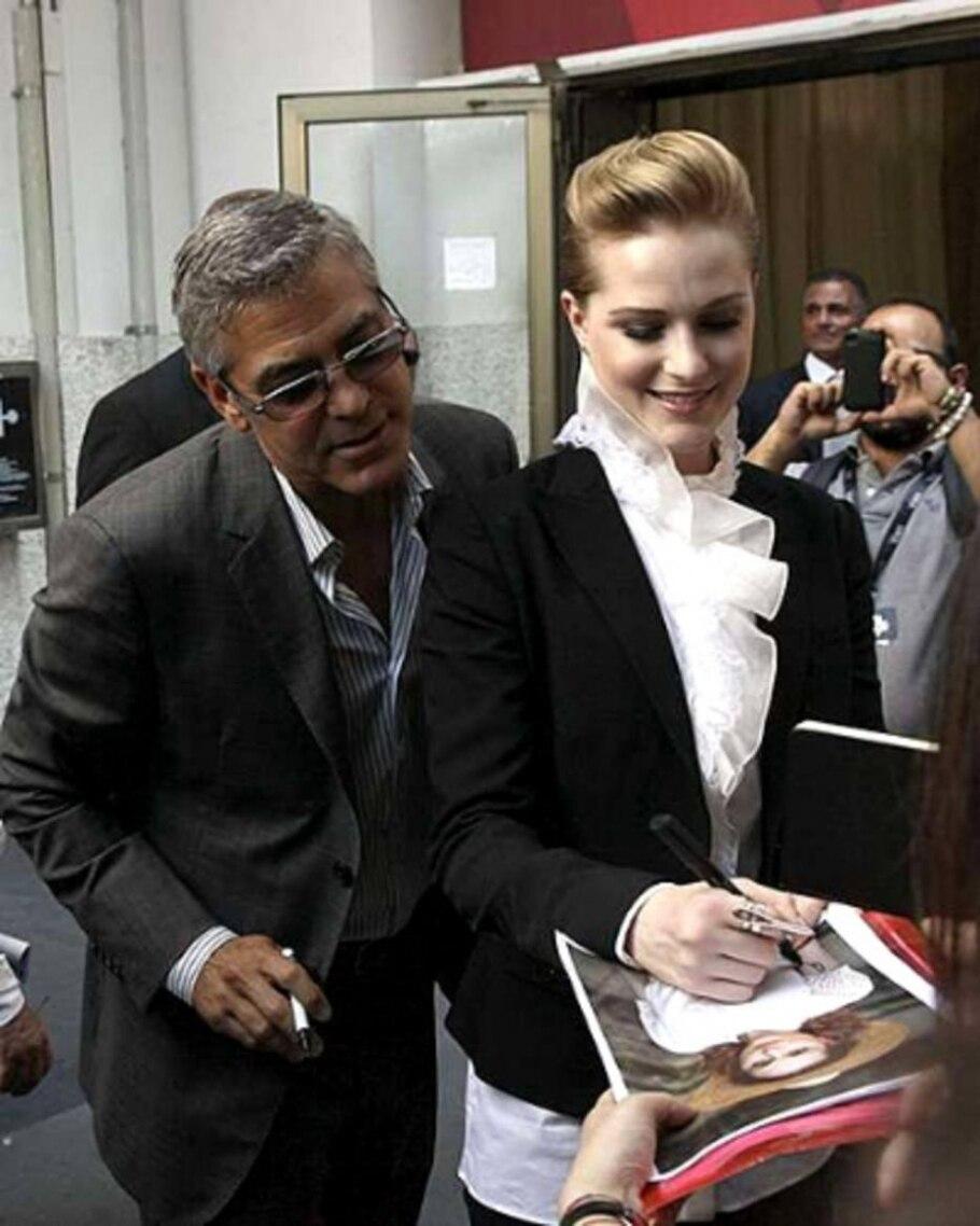 George Clooney e Evan Rachel Wood atendem fãs - Alessandro Bianchi/Reuters