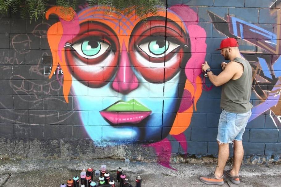 Grafite contra a enchente - MARCIO FERNANDES DE OLIVEIRA/ESTADAO