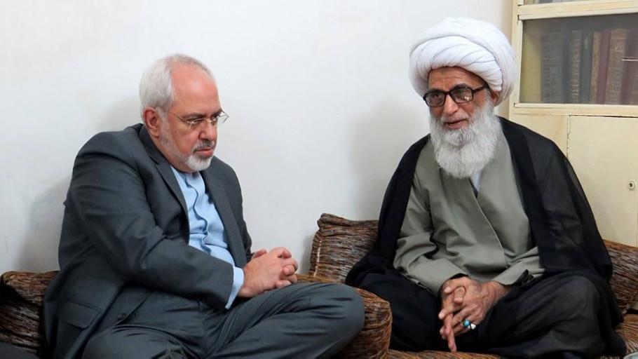 Ministro iraniano ao lado de aiatolá - HAIDAR HAMDANI/AFP