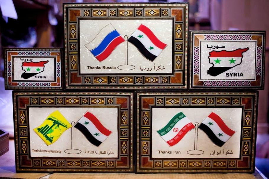 Putin, Assad, Irã e Hezbollah viram souvenirs da guerra síria  - AP Photo/Hassan Ammar