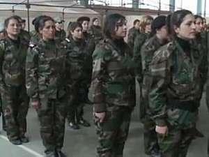Mulheres entram em grupo paramilitar para lutar por Assad