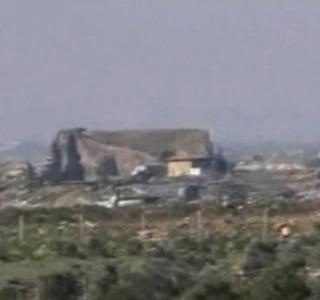 Syrian government TV, via AP
