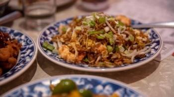 O cardápio do Pekin Noodle Parlor inclui pratos que datam da fundação do restaurante. Foto: Louise Johns/The New York Times