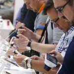 Journalists check out the Samsung Galaxy Gear smartwatch at the booth of Samsung during a media preview day at the IFA consumer electronics fair in Berlin