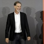 Netflix co-founder and CEO Reed Hastings smiles as he poses for photographers during an event to launch the streaming service in Italy, in Milan