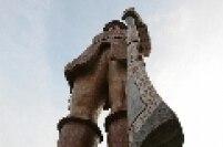 Obra do escultor Júlio Guerra, que para realizá-la utilizou trilhos de bonde para compor a estrutura de concreto, posteriormente revestida com pedras coloridas de basalto e mármore.