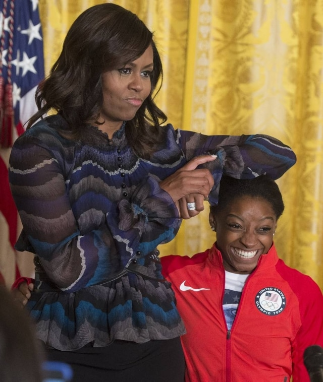 Michelle Obama e Simone Biles.