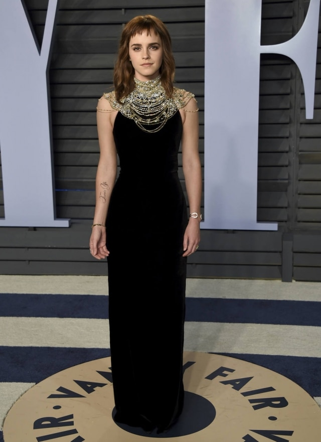 Emma Watson arrives at the Vanity Fair Oscar Party on Sunday, March 4, 2018, in Beverly Hills, Calif. (Photo by Evan Agostini/Invision/AP)