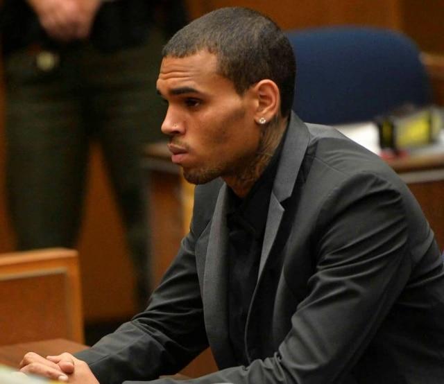 Chris Brown, em julho de 2013, participa de audiência apósacusações de atropelamento e fuga em Los Angeles.