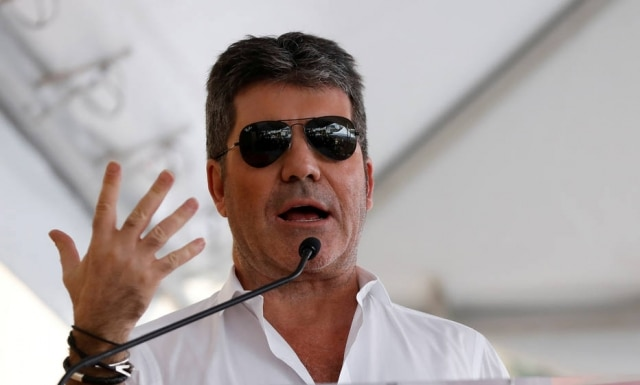 FILE PHOTO: Producer Simon Cowell speak at the Hollywood Walk of Fame in Los Angeles, California U.S., March 22, 2017.   REUTERS/Mario Anzuoni/File Photo