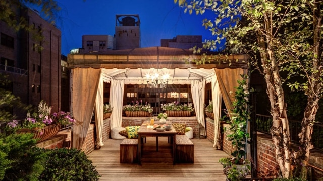 The rooftop garden and terrace at the remodeled condominium of Cristiane Peixoto and Marcus Silberman, New York, June 7, 2014. The three-level terrace was designed by Maureen Hackett in 2005 and updated by Peter Pawlak last year. (Bruce Buck/The New York Times)