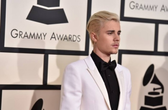 Justin Bieber não se conteve ao responder paparazzo.